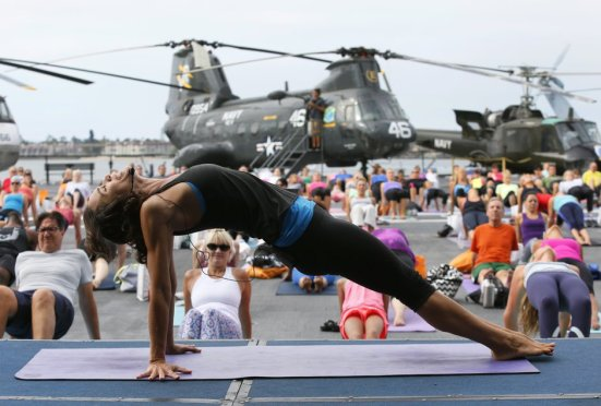 Amy Caldwell from Yoga One teaching aboard the USS Midway