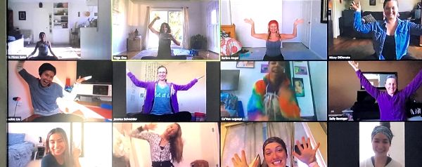 students practice yoga over zoom video chat